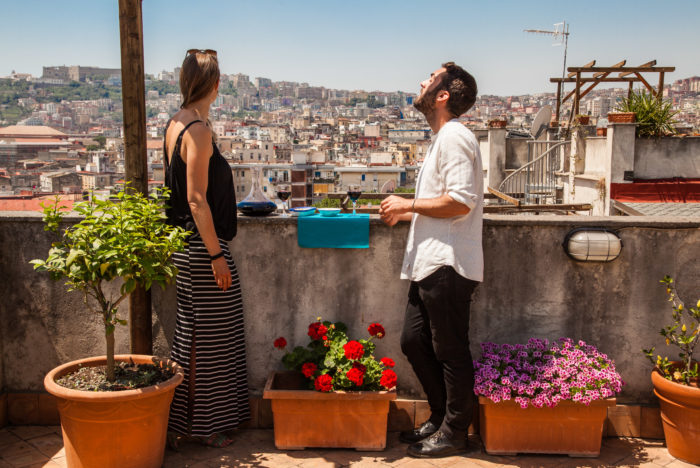 Two people on rooftop in Naples